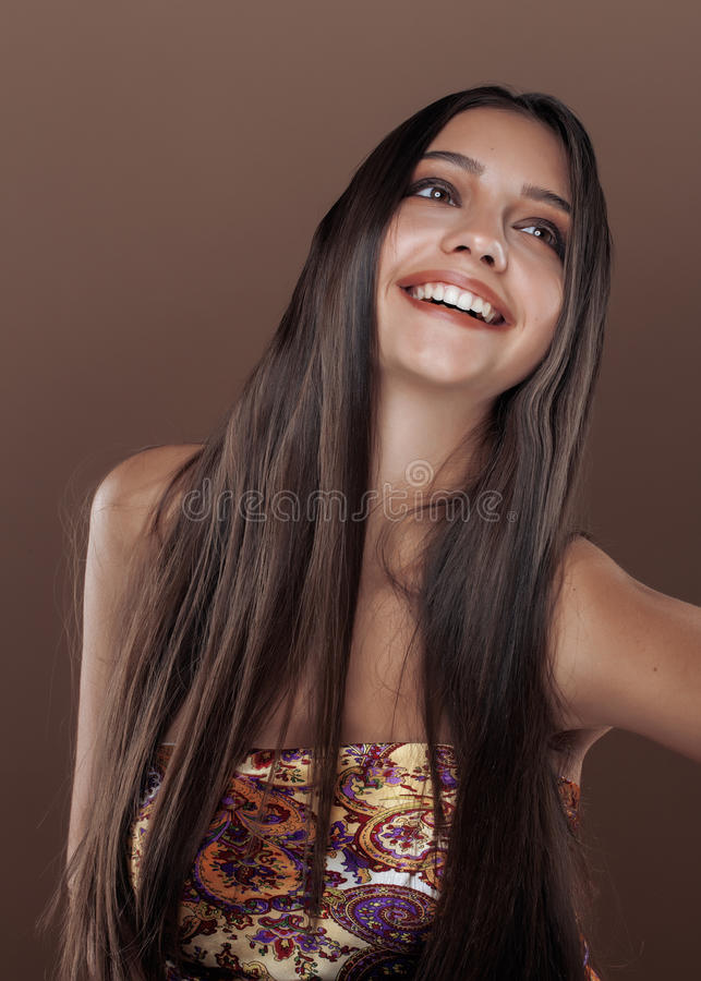 Cute happy young indian woman in studio close up royalty free stock images
