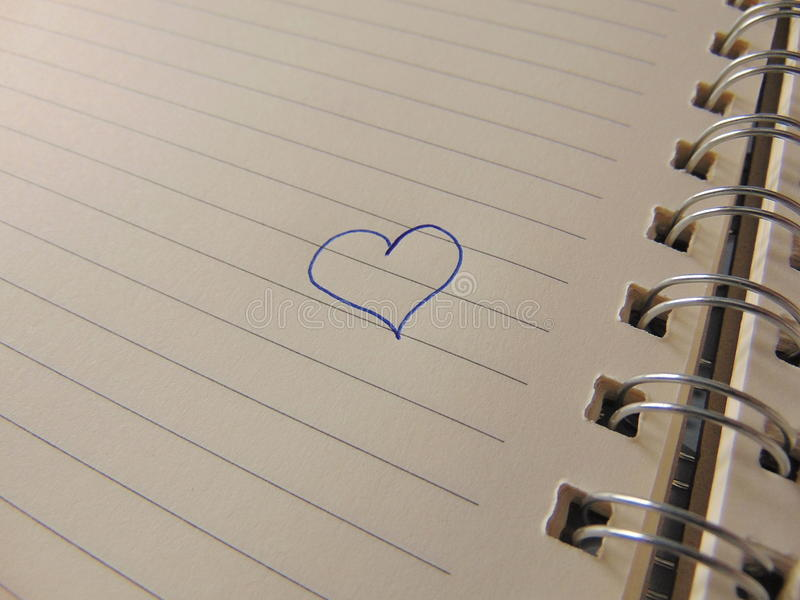 Cute heart drawn in notebook. With blue pen stock photo