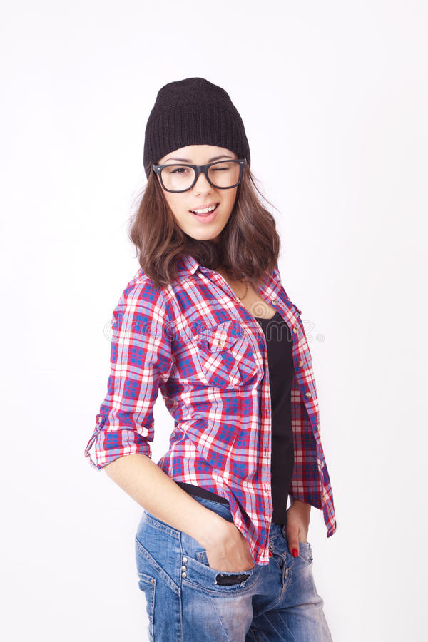 Cute hipster teenage girl with beanie hat. Posing looking at camera royalty free stock photos