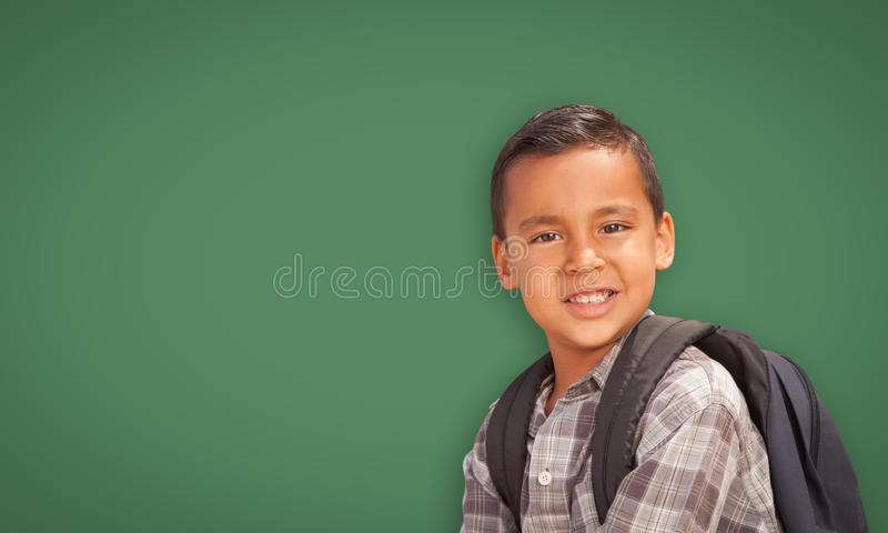 Cute Hispanic Boy In Front of Blank Chalk Board stock photography