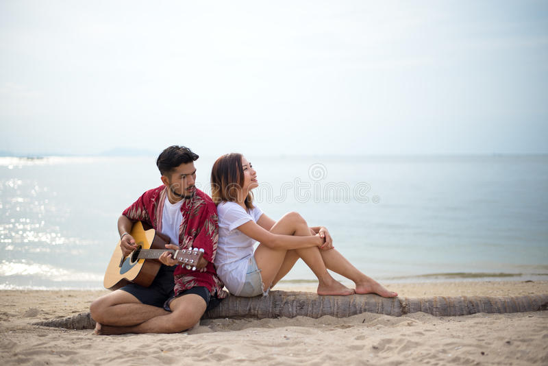 Cute hispanic couple playing guitar serenading royalty free stock image