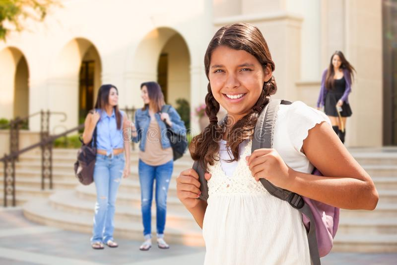 Cute Hispanic Teen Girl Student Walking on School Campus. With a Backpack royalty free stock image