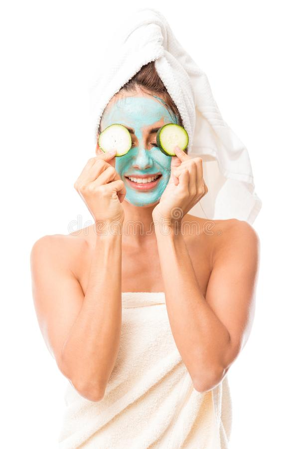 Cute Hispanic woman with a facial mask stock photography