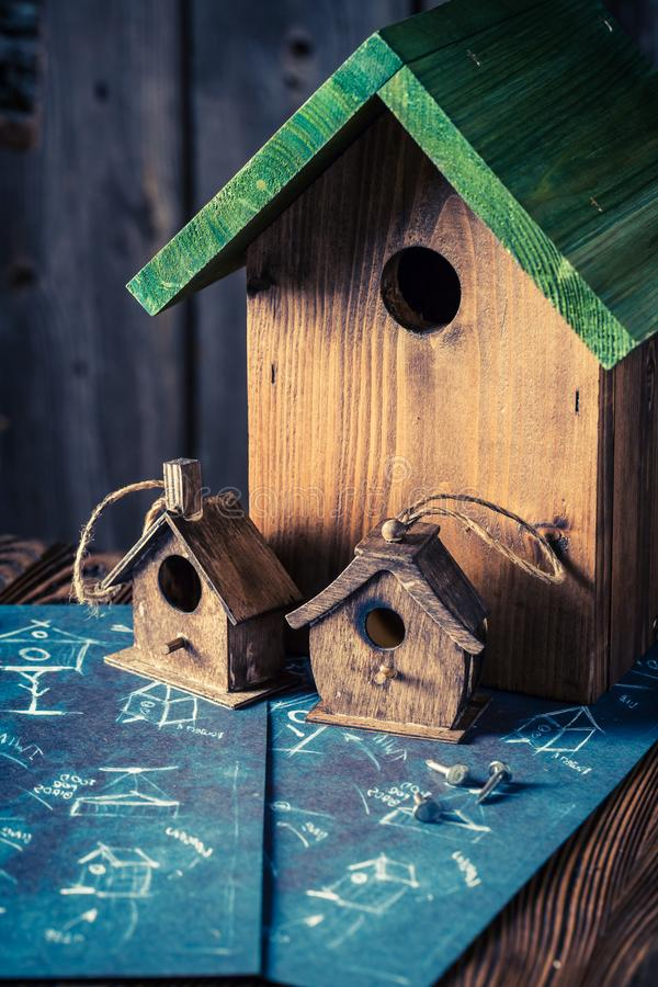 Cute home for birds in wooden workshop. Closeup of cute home for birds in wooden workshop stock photography