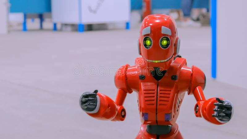 Cute humanoid robot. Portrait of red cute humanoid robot at exibition. Technology and robotics concept royalty free stock images