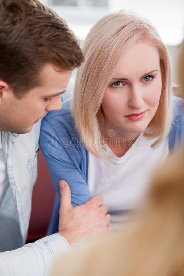 Cute husband and wife are using marriage therapy stock photo