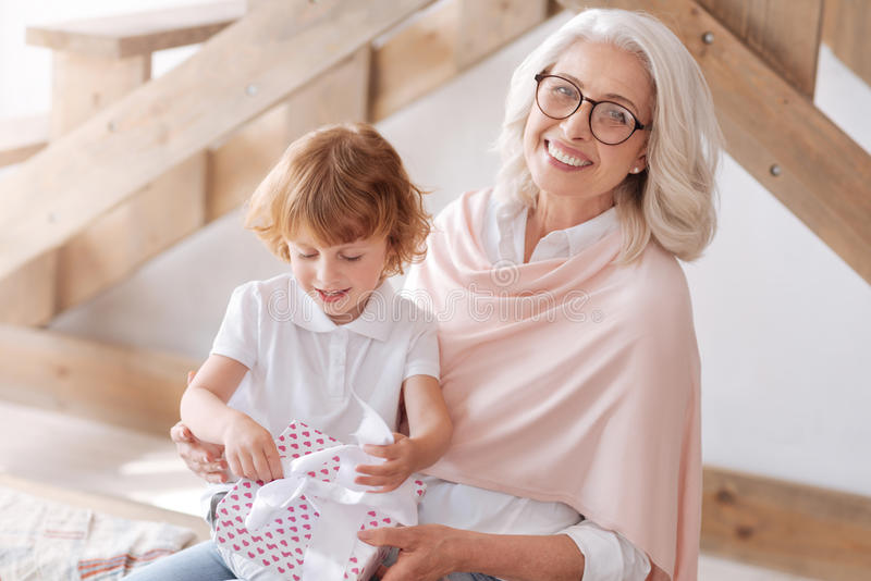 Cute impatient boy looking at his present royalty free stock images