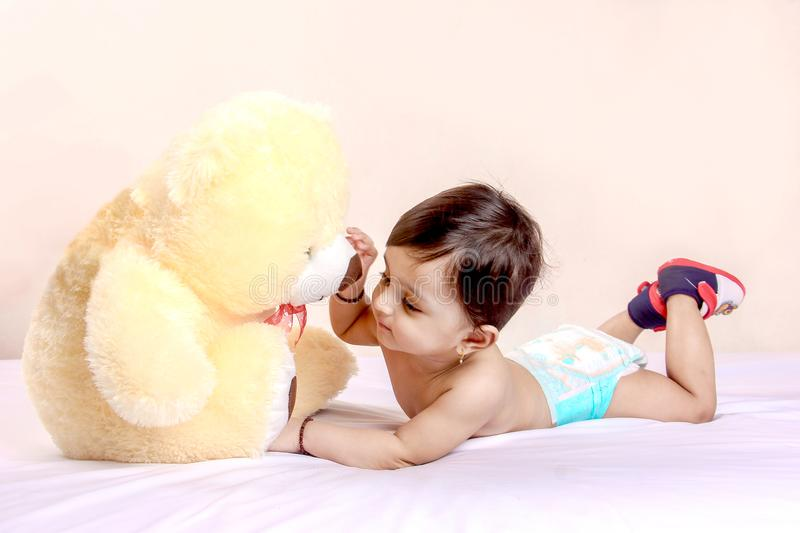 Cute Indian baby child playing with toy royalty free stock images