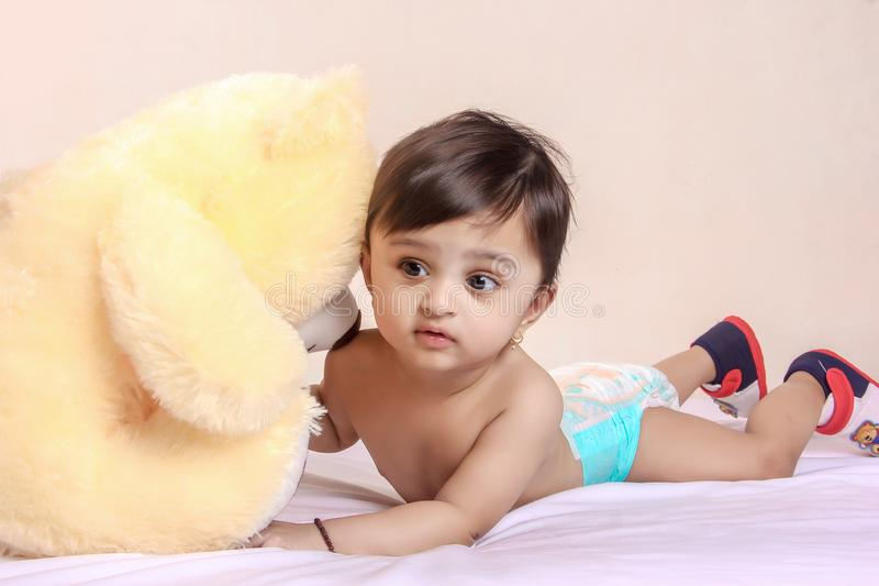 Cute Indian baby child playing with toy stock photos