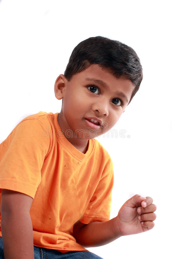 Cute Indian Kid. A portrait of a cute Indian kid, on a white background royalty free stock images
