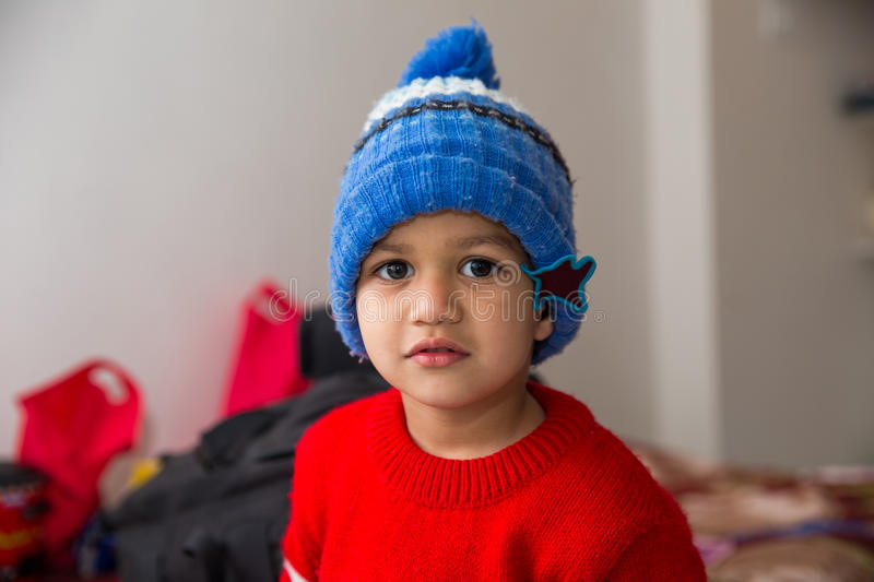 Cute Indian Kid striking a pose in winter wear with a cute smile stock photo