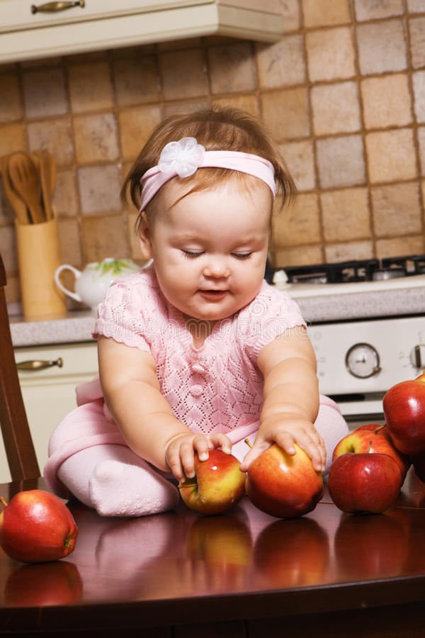 Download Cute Infant Girl Playing At Kitchen Stock Image - Image: 16778945