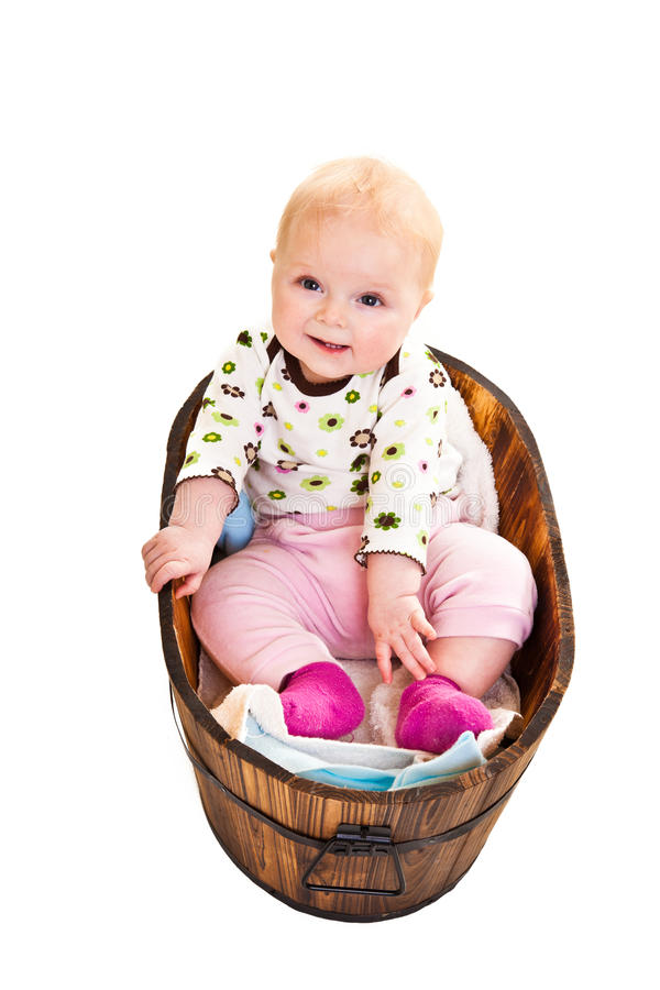 Cute infant in wooden bucket stock photography