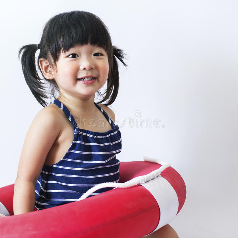 Cute and innocent asian kid with life ring on white backgroun. D stock photography