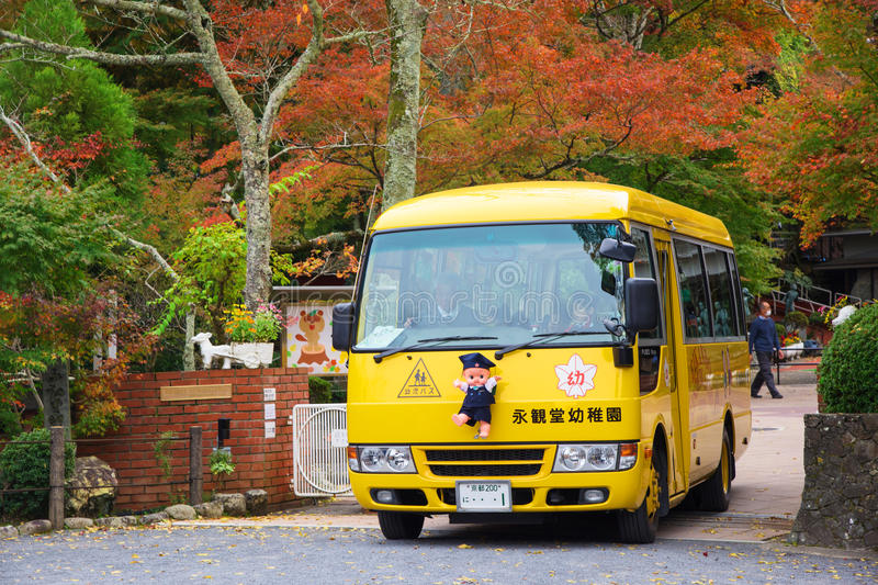 Cute Japan school bus. KYOTO, JAPAN - NOVEMBER 13, 2015: Unidentified children in cute school bus on the way to send students back from school royalty free stock photography