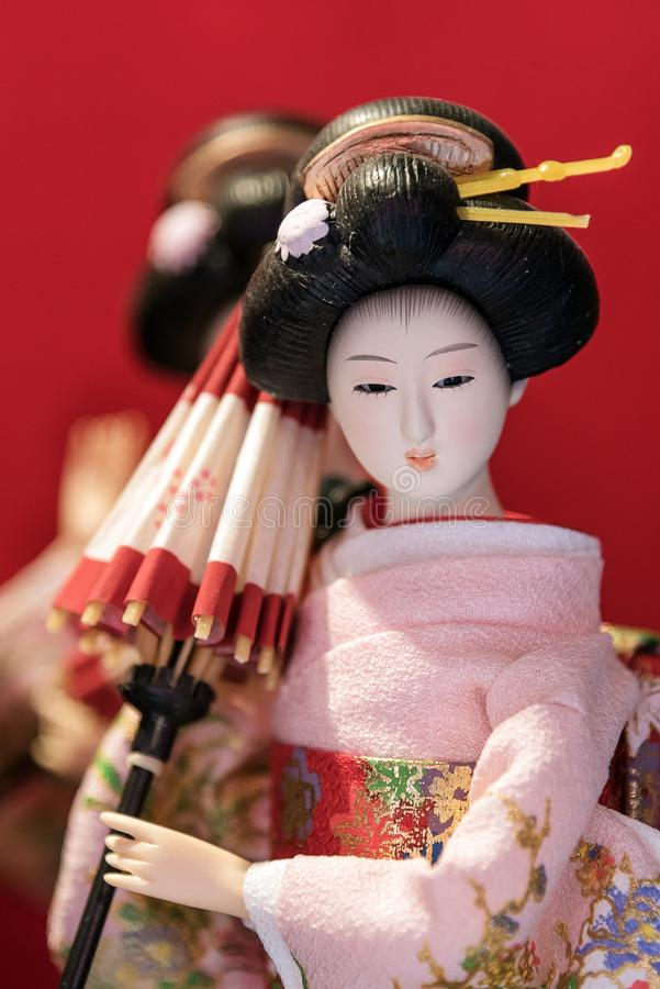 Cute Japanese traditional doll in kimono costume royalty free stock images