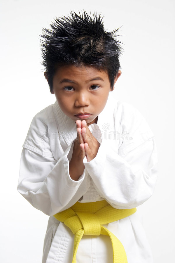 Free Cute Karate Kid Bowing Royalty Free Stock Photography - 188377