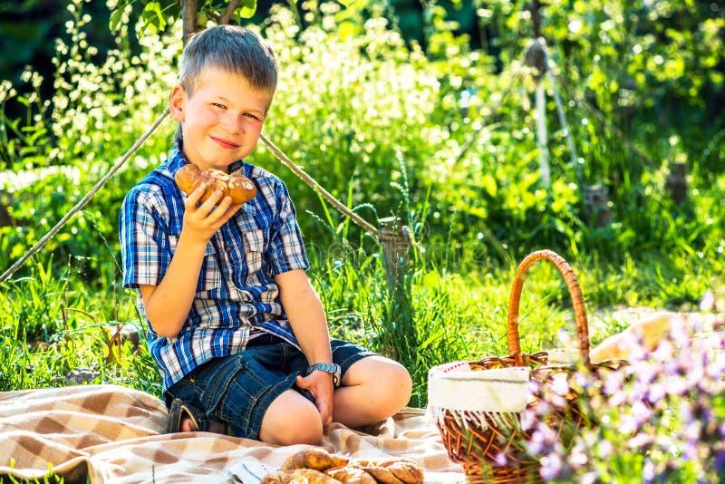 Cute kid boy having picnic royalty free stock photo