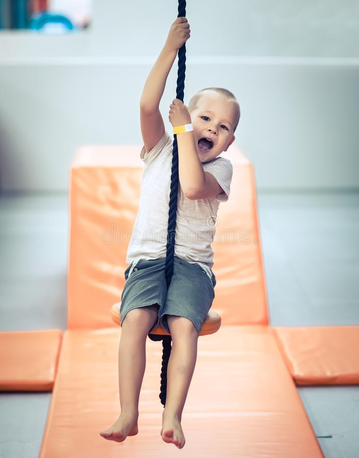 Cute kid boy at playground stock photography