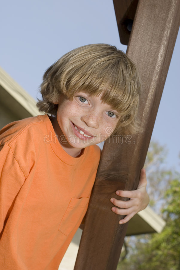 Cute kid climbing a playset royalty free stock photography
