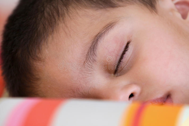 Cute kid in deep sleep stock images