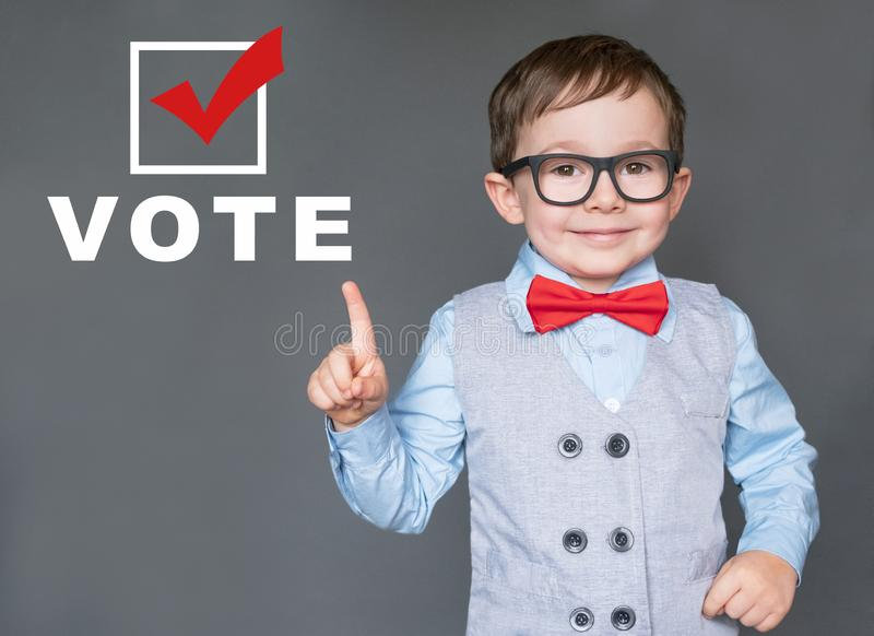 Cute Kid encouraging others to register and vote. Well dressed Kid encouraging others to register and vote stock photography