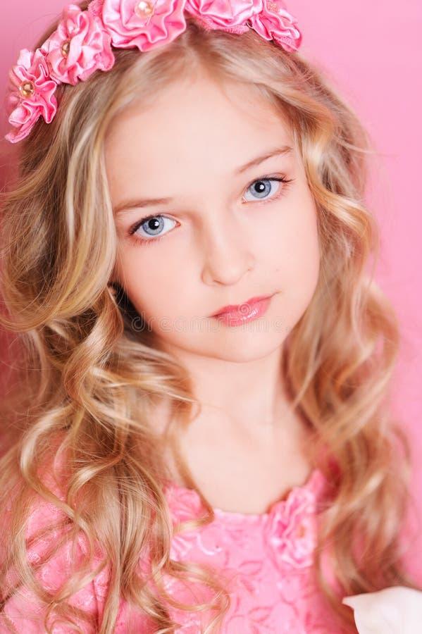 Cute kid girl on pink stock photos