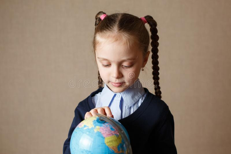Cute kid with globe. royalty free stock photo