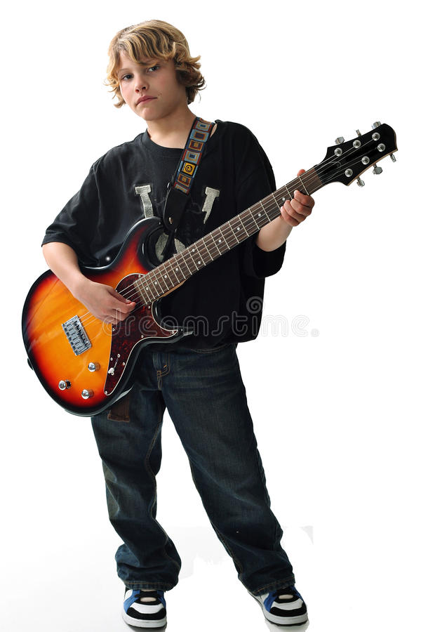 Cute kid with guitar upclose vertical stock image