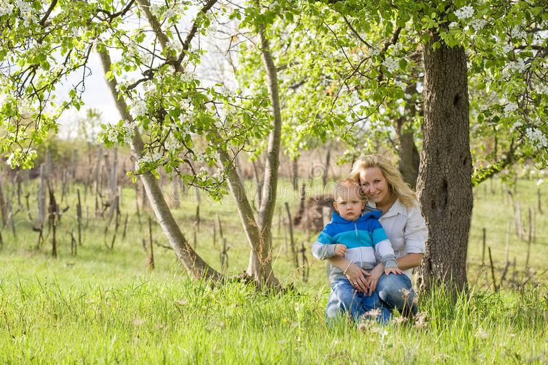 Download Cute Kid With His Mom Outdoors In Nature. Stock Photo - Image: 24716958