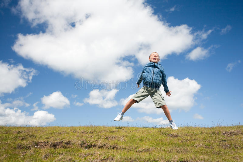 Download Cute kid jumping for joy stock photo. Image of jump, body - 10343742