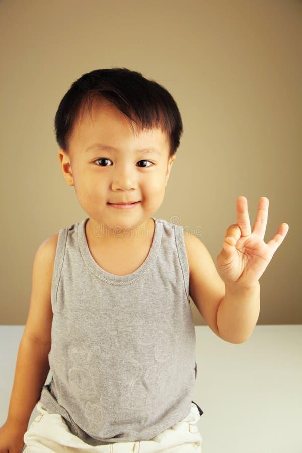 Cute kid looking at viewer stock image