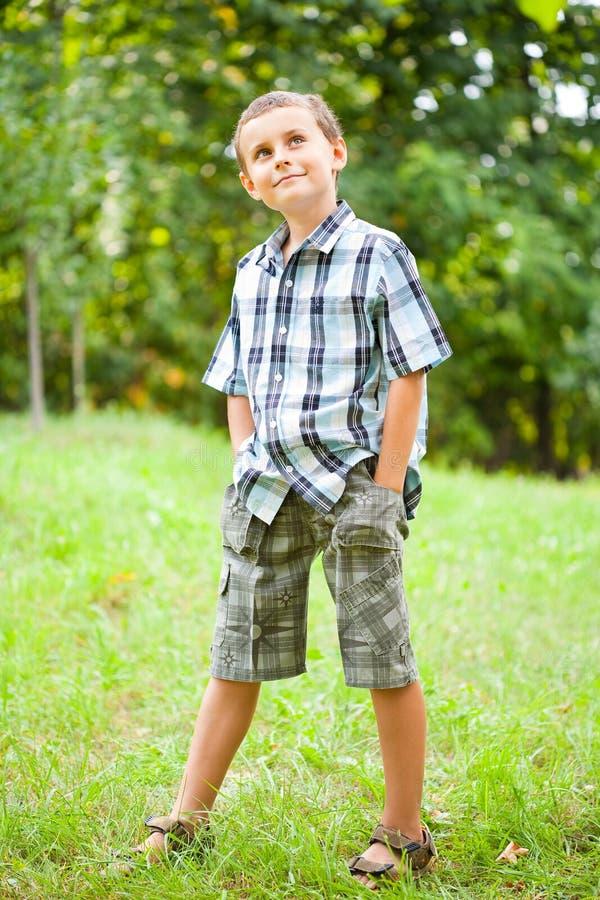 Cute kid outdoors in a grass field stock photos