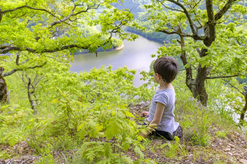 Cute Kid Playing at Lake Destination Scenery royalty free stock photography