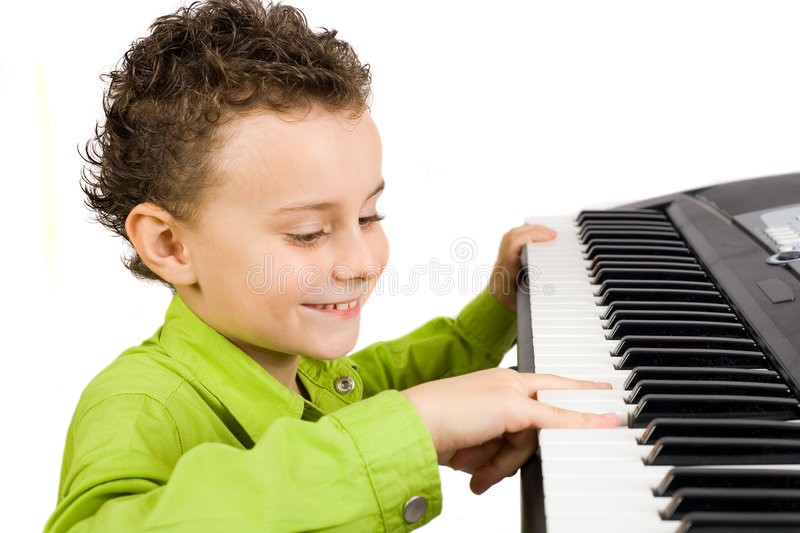 Download Cute kid playing piano stock image. Image of handsome - 7834015