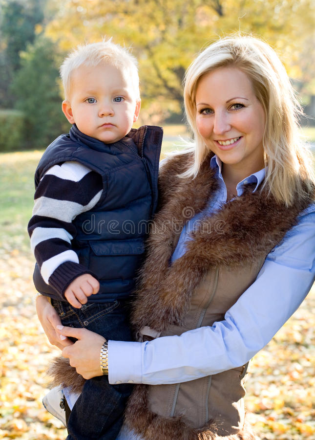 Download Cute Kid And Pretty Mom Outdoors At Fall. Stock Image - Image: 24780317