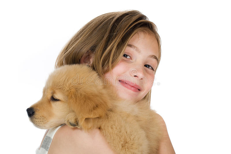 Cute kid with a puppy stock photos