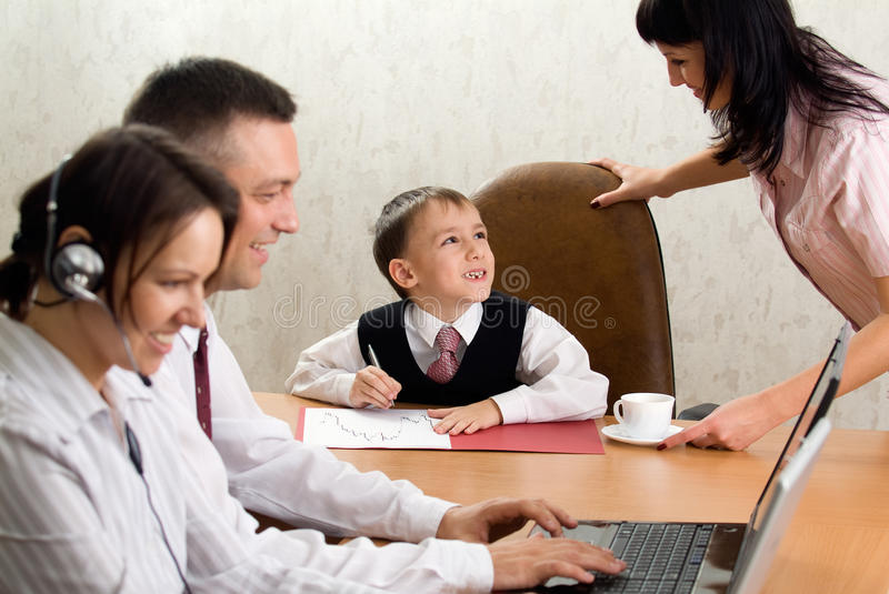 Cute kid in the role of an office manager stock photo