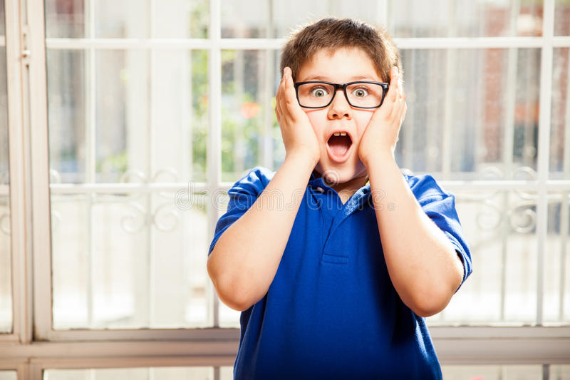 Cute kid in shock stock photo