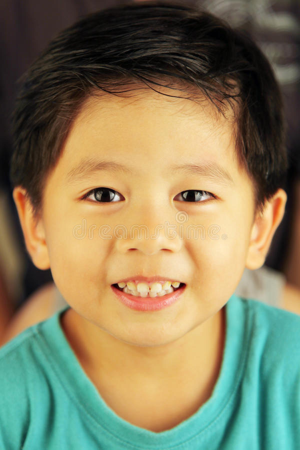 Cute kid smiling. At viewer stock images