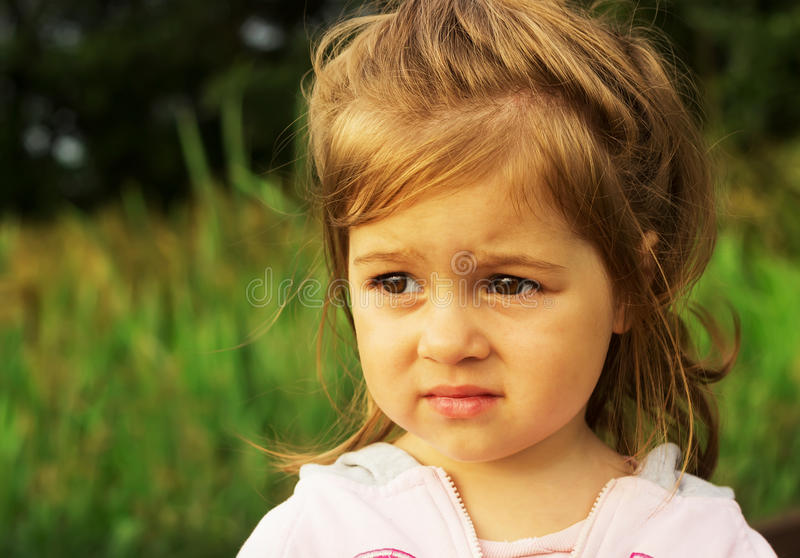 Cute kid thinking outdoor stock photography