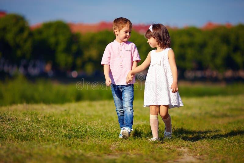 Cute kids couple walking on summer field stock image image of download cute kids couple walking on summer field stock image image of garden thecheapjerseys Gallery