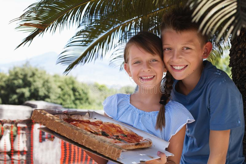 Food concept. Pizza. Cute kids holding pizza. Food concept stock image