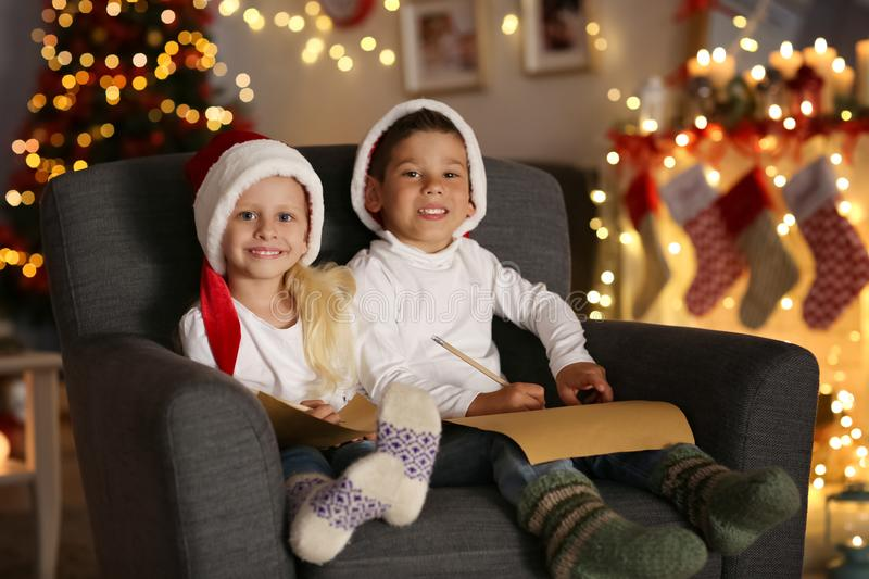 Cute kids with letters to Santa in room royalty free stock photo
