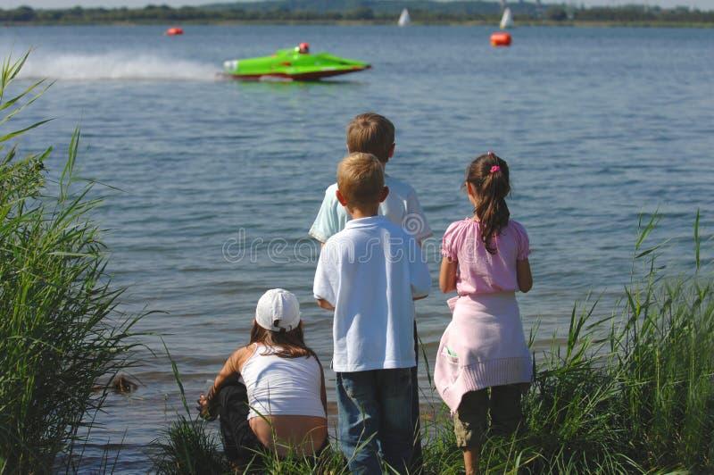 Cute kids at motorboat wm royalty free stock image