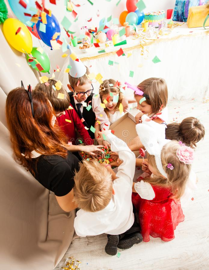The games with animator. Cute kids playing with animator on the birthday party. Cat women entertains the guests royalty free stock image
