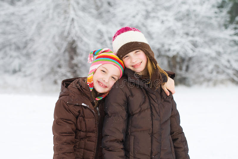 Cute kids playing in the snow stock photo
