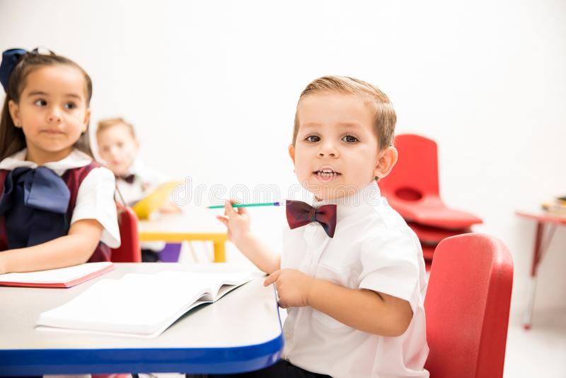 Cute kindergarten pupil in a classroom stock photo