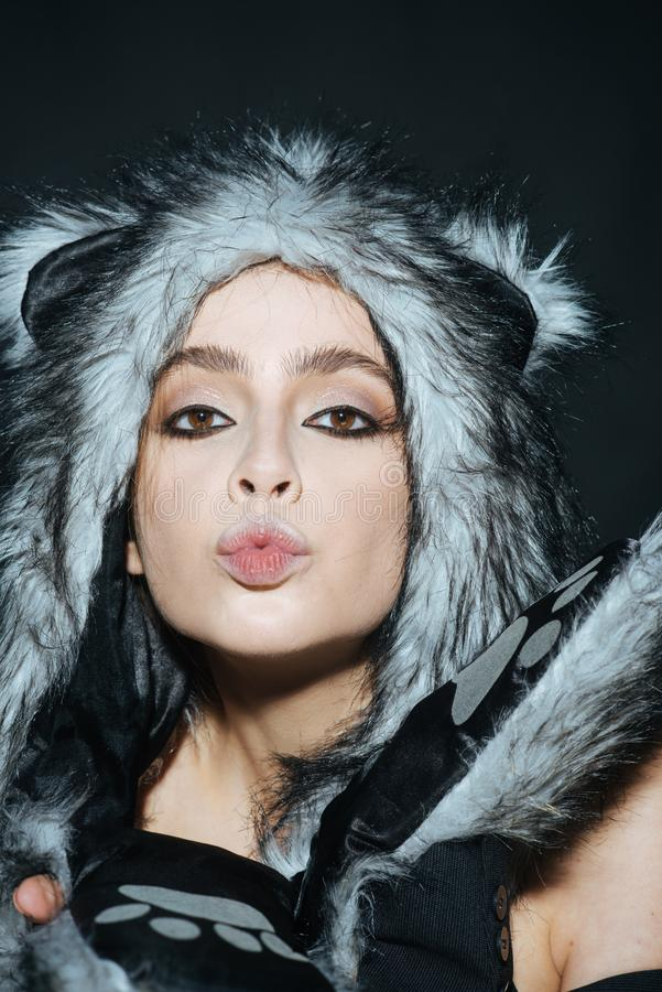 Cute kitty outfit. Carnival and Halloween ideas. Cute outfit to celebrate carnival. Woman wear furry hat with little. Ears like cat or kitten. Girl with makeup stock photo