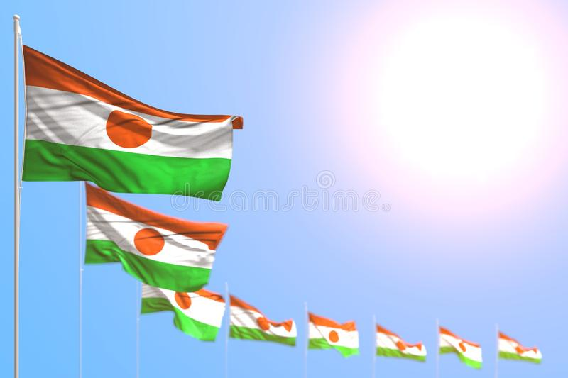 Pretty many Niger flags placed diagonal with selective focus and free place for content - any celebration flag 3d illustration. Cute labor day flag 3d vector illustration